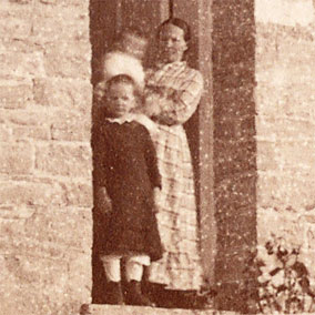 This enlarged portion of a summer 1883 photo shows Emily Betts and two of her children in the front doorway of the Pottawatomie Lighthouse, Rock Island, Wisconsin. (National Archives, image 26-LG-56a-87-ac.)