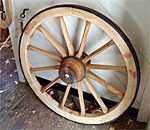 Hand made iron bound wooden wagon wheel produced at Colonial Williamsburg historic site in Virginia. Photo by bestselling author Kathleen Ernst.