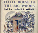 Partial front cover image of Little House in the Big Woods children's book by Laura Ingalls Wilder, published by Harper & Brothers, 1932.