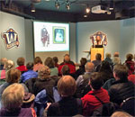 "Photo by Scott ""Mr. Ernst"" Meeker of bestselling author Kathleen Ernst talking about her nonfiction history book A Settler's Year: Pioneer Life Through The Seasons to a standing room only crowd at the Wisconsin Historical Society Muesum in Madison, Wisconsin, on February 16, 2016."