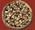 Color photo of a pear cranberry pie made by author Kathleen Ernst.