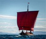 Color photo of Viking long ship Draken Harald Harfagre sailing across the Atlantic Ocean from Norway to North America in May 2016.