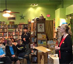 Photo by Joanne Berg of Mystery To Me bookstore of bestselling author Kathleen Ernst speaking about her seventh Chloe Ellefson mystery book, A Memory of Muskets, at its official launch party October 4, 2016 in Madison, WI.