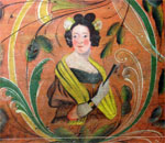 Photo of a young woman doing in Norwegian rosemaling (rose painting) on the wooden shipping trunk painted by Ola Eriksen Tveitejorde, of Voss, Norway, from the collection of Vesterheim Norwegian-American Museum, Deborah, Iowa.