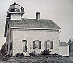 Historic photo of Pottawatomie Lighthouse on Rock Island, Wisconsin, in Lake Michigan.