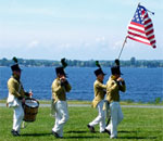 Photo of War of 1812 reenactors on parade at Sackets Harbor Battlefield.