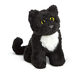 Plush toy of Caroline's pet cat Inkpot, available from American Girl