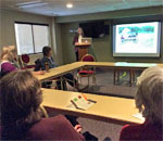 Photo of bestselling author Kathleen Ernst giving her illustrated A Settler's Year program at the City of Madison WI Senior Citizens Center on February 9, 2016.