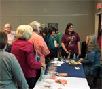 Photo of readers lined up to have bestselling author Kathleen Ernst sign copies of her new non-fiction book A Settler's Year: Pioneer Life Through The Seasons, on September 18, 2015 at the Waukesha Wisconsin Public Library.