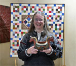 Photo of bestselling author Kathleen Ernst with artifacts that inspired her Chloe Ellefson Historic Sites mystery series books.