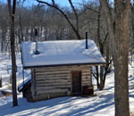 Photo by author Kathleen Ernst of 1853 Fern Hollow Cabin in NE Iowa, owned by Liz Rog and Daniel Rotto.