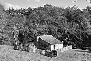 Black and white photo of a cabin taken by author Kathleen Ernst.