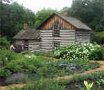 Photo by bestselling author Kathleen Ernst of the Pedersen Farm cabin at Old World Wisconsin outdoor ethnic history museum, located near the Village of Eagle, Wisconsin.