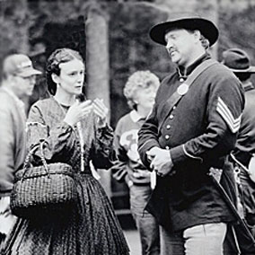 Kathleen Ernst and Nels Monson in 1860's period clothing speaking at a Civil War reenactment at Old World Wisconsin circa mid-1980's. Photographer unknown.