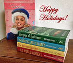 Photo of Caroline Abbott six book box set and first four Choe Ellefson mysteries.