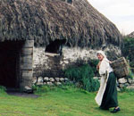 Photo of an interpreter at a Scottish outdoor museum.