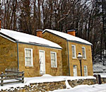 Color photo of a stone cottage at Pendarvis Historic Site in Mineral Point, Wisconsin.