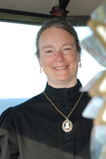 "Photo of Kathleen Ernst, author of ""The Light Keeper's Legacy, the third book in the Chloe Ellefson Historic Sites mystery series from publisher Midnight Ink. Photo taken at Pottawatomie Lighthouse, Rock Island State Park, Wisconsin, by Kay Klubertanz."