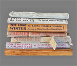 Stack of books written by bestselling children's author Laura Ingalls Wilder. Photo by bestselling author Kathleen Ernst.