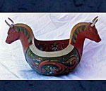 Photo of hand carved and rosemaled Norwegian ale bowl with cows head handles.