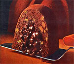Color photo of a slice of Tunnel of Fudge cake, taken from 17th annual Pillsbury Busy Lady Bake-Off Recipes booklet of 1966.