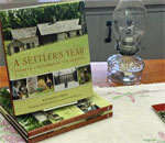 Copies of A Settler's Year: Pioneer Life Through The Seasons, for sale at the Old World Wisconsin gift shop. Photo taken by Joanne Triebold Himebauch on August 3, 2015.