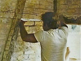 Photo of Marty Perkins reassembling the Koepsell House at Old World Wisconsin in 1975. Photo by Old World Wisconsin.