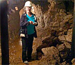 Bestselling author Kathleen Ernst exploring the 65 foot deep historic lead mine maintained by the Badger Mining Museum in Shullsburg, Wisconsin. Photo by Scott Meeker.