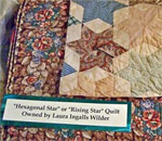 Photo by author Kathleen Ernst of the Hexagonal Star (also called the Rising Star) pattern quilt owned by Laura Ingalls Wilder, now in the collection of the Laura Ingalls Wilder Museum, in Walnut Grove, MN.