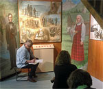 Photo of members of the March 11-13, 2016 Exploring Your Heritage: A Writing Sampler Weekend at Vesterheim Norwegian-American Museum, taught by bestselling author Kathleen Ernst, who took this photo of class members writing amongst the museum's exhibits.