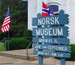 Norsk Museum, Norway, Illinois, entrance sign and flags. Photo by Kathleen Ernst.