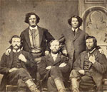 Sepia photograph of five well dressed young men posing.