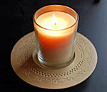Photo of chip carved candle holder and candle.