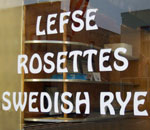 Photo of a Lefse, Rosettes and Swedish Rye sign on window of Schubert's Diner and Bakery in Mount Horeb, WI.