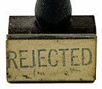 "Image of a old-fashioned hand stamp labeled ""REJECTED""."