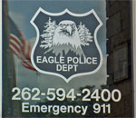 Photo of the front door to the Wisconsin Village of Eagle Police Department. Photo taken 2010 by Scott Meeker.