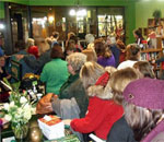 Photo of readers at Heritage of Darkness launch party at Mystery To Me, Madison, WI.