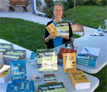 Photo of bestselling author Kathleen Ernst signing books at the Door County Books and Authors Festival on September 26, 2015 in Fish Creek, Wisconsin.