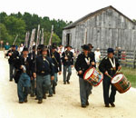 Third Wisconsin Civil War reenacting unit marching at Ol World Wisconsin. Photographer unknown.