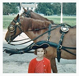 Color photo of bestselling author Kathleen Ernst as a child visiting the Colonial Williamsburg historic site in Virginia.