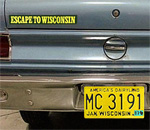 1969 AMC Rambler sedan driver's side rear bumper with Escape to Wisconsin sticker and yellow Wisconsin license plate with 1983 sticker. Photo by by Scott Meeker.