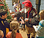 Photo of a modern Norwegian Christmas Nisse handing out presents at Vesterheim Norwegian-American Museum.