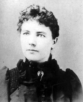 Black and white photo of Laura Ingalls Wilder taken circa 1894 when she was about 27 years old. Photographer unknown. Image source: Wikipedia.