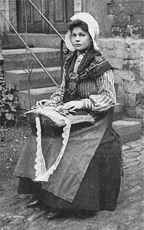 Belgian woman making lace. Cropped black & white carte postale image circa 1920 by Nels, Bruxelles, Series Laitiere No. 14 in the collection of author Kathleen Ernst.