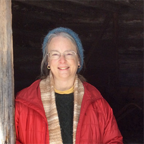 Bestselling author Kathleen Ernst at the Belgium Massart family log barn at Heritage Hill State Historic Park, Green Bay, Wisconsin.