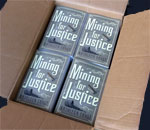 Shipping carton of Mining For Justice, the 8th Chloe Ellefson mystery book by bestselling author Kathleen Ernst, published by Midnight Ink Books 2017.