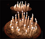 Photo of Holiday candles ablaze by Kathleen Ernst.