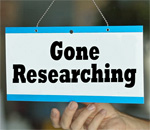 Window sign saying Gone Researching. Graphic by Deep Vee Productions.