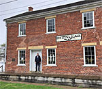 Tom McKay, president of the Hampton Illinois Historical Society at the 1849 Brettun & Black store building they restored on the eastern bank of the Mississippi River.
