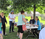 Photo of author Kathleen Ernst and Mr Ernst selling Chloe Ellefson books at the Belgian Farm at Heritage Hill Historic Park in Green Bay.